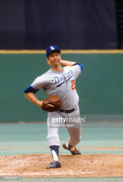 Tommy John of the Los Angeles Dodgers pitches against the Philadelphia Phillies during a Major League Baseball game circa 1975 against the...