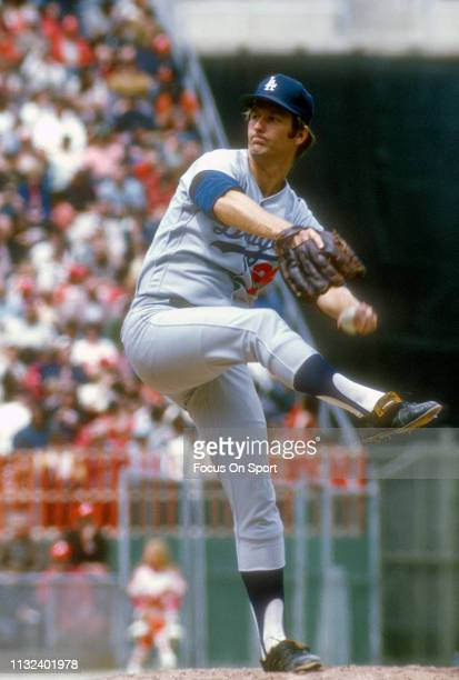 Tommy John of the Los Angeles Dodgers pitches against the Philadelphia Phillies during a Major League Baseball game circa 1974 against the...