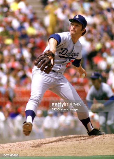 Tommy John of the Los Angles Dodgers pitching during a game from his 1974 season with the Los Angles Dodgers. Tommy John played for 26 years with 6...
