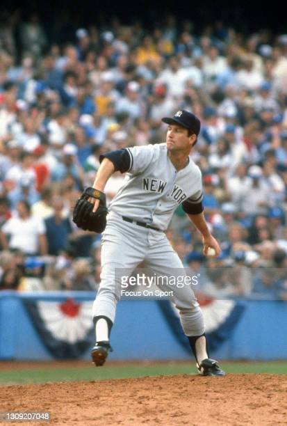 Tommy John of the New York Yankees pitches against the Los Angeles Dodgers during the 1981 World Series on October 25, 1981 at Dodgers Stadium in Los...