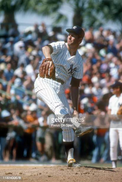 Tommy John of the New York Yankees pitches during a Major League Baseball spring training game circa 1979 at Yankee Stadium in Fort Lauderdale...