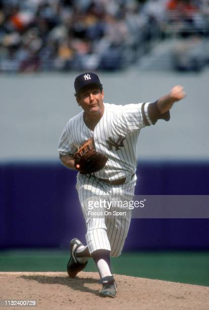 Tommy John of the New York Yankees pitches during a Major League Baseball game circa 1980 at Yankee Stadium in the Bronx borough of New York City....