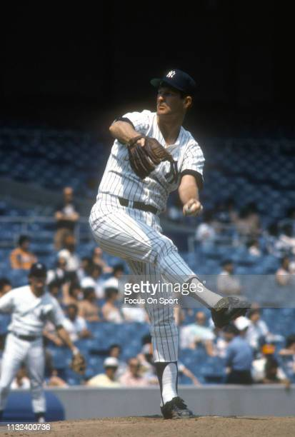 Tommy John of the New York Yankees pitches during a Major League Baseball game circa 1979 at Yankee Stadium in the Bronx borough of New York City....
