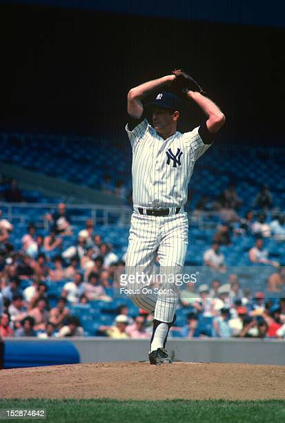 Tommy John of the New York Yankees pitches during an Major League Baseball game circa 1979 at Yankee Stadium in the Bronx borough of New York City...