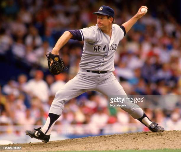 Tommy John of the New York Yankees pitches during an MLB game against the Detroit Tigers at Tiger Stadium in Detroit, Michigan during the 1987 season.