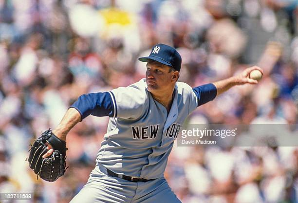 Tommy John of the New York Yankees pitches in a Major League Baseball game against the Oakland Athletics played on May 18 1989 at the OaklandAlameda...
