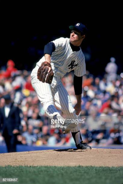 Tommy John of the New York Yankees winds up the pitch during a game in 1979 at Yankee Stadium in the Bronx New York