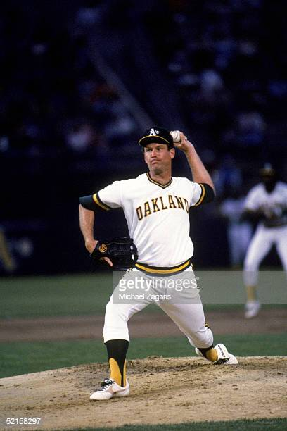 Tommy John of the Oakland Athletics delivers a pitch during a game against the Detroit Tigers at OaklandAlameda County Coliseum on August 22 1985 in...