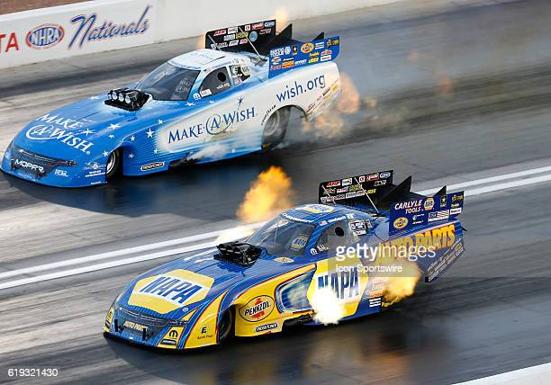Tommy Johnson Jr Don Schumacher Racing Dodge Charger NHRA Funny Car and Ron Capps Don Schumacher Racing Dodge Charger NHRA Funny Car during the NHRA...