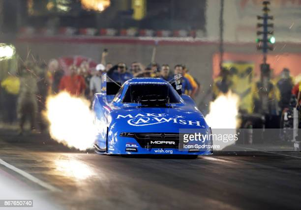 Tommy Johnson Jr Don Schumacher Racing Dodge Charger NHRA Funny Car races down the track during the NHRA Toyota Nationals on October 28 2017 at The...
