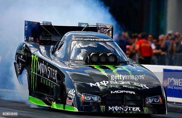 Tommy Johnson Jr driver of the Monster Energy funny car does his burn out during qualifying for the NHRA Carolinas Nationals at the Zmax Dragway on...