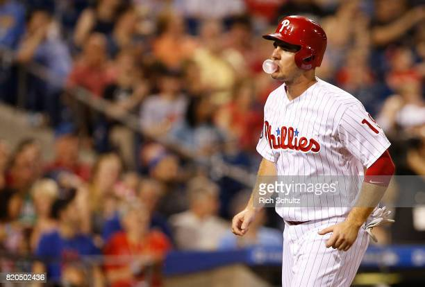 Tommy Joseph of the Philadelphia Phillies blows a bubble as he scores on a bases loaded walk to Andrew Knapp during the sixth inning of a game...