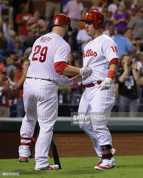 Tommy Joseph of the Philadelphia Phillies celebrates with Cameron Rupp after hitting solo home run in the bottom of the sixth inning against the...