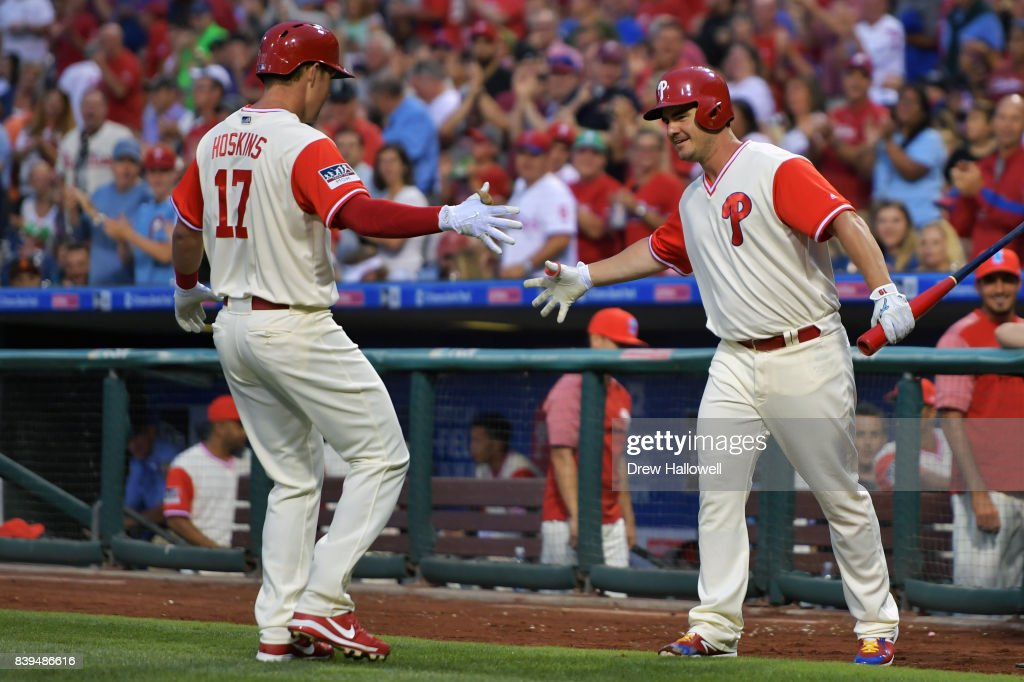 Tommy Joseph #19 of the Philadelphia Phillies congratulates teammate Rhys Hoskins #17 on a two run home run in the first inning against the Chicago Cubs at Citizens Bank Park on August 25, 2017 in Philadelphia, Pennsylvania.