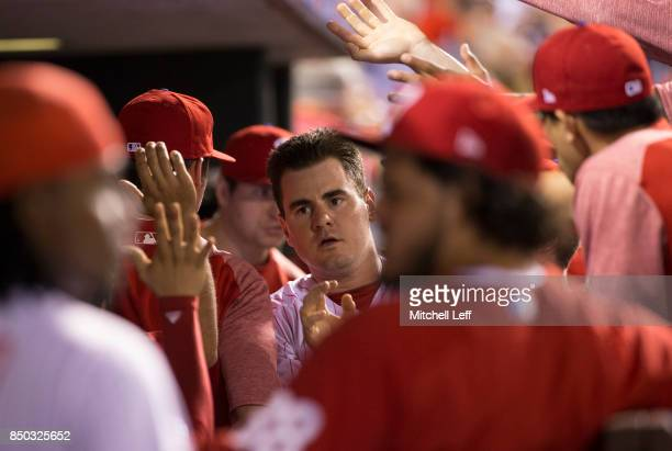 Tommy Joseph of the Philadelphia Phillies high fives his teammates after scoring a run in the bottom of the second inning against the Los Angeles...