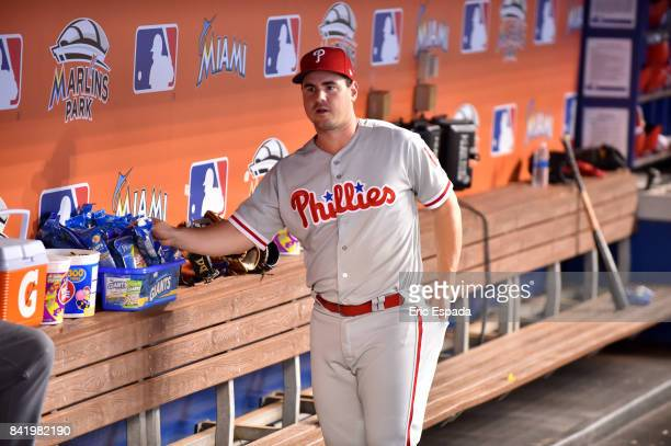 Tommy Joseph of the Philadelphia Phillies in the dugout before the start of the game against the Miami Marlins at Marlins Park on September 2 2017 in...