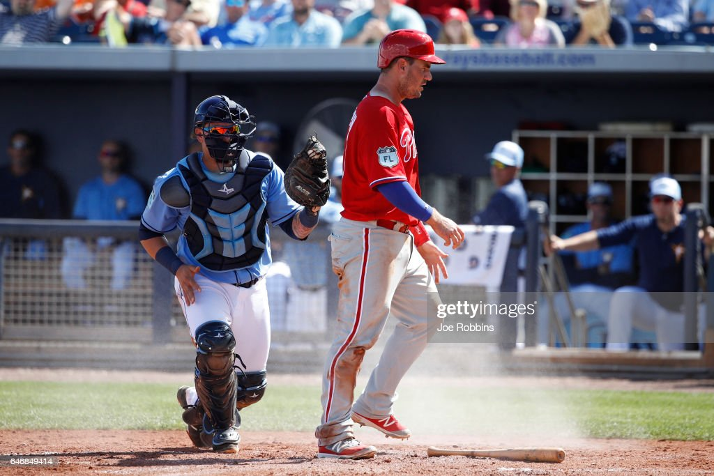 Tommy Joseph #19 of the Philadelphia Phillies reacts after being tagged out at home plate by Jesus Sucre #45 of the Tampa Bay Rays in the fourth inning of a Grapefruit League spring training game at Charlotte Sports Park on March 1, 2017 in Port Charlotte, Florida. The game ended in a 5-5 tie.