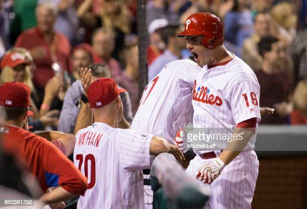 Tommy Joseph of the Philadelphia Phillies reacts after hitting a solo home run in the bottom of the seventh inning against the Los Angeles Dodgers at...