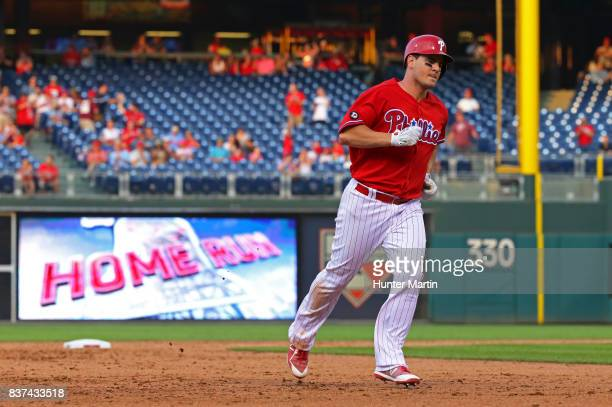 Tommy Joseph of the Philadelphia Phillies rounds the bases after hitting a solo home run in the ninth inning during a game against the Miami Marlins...