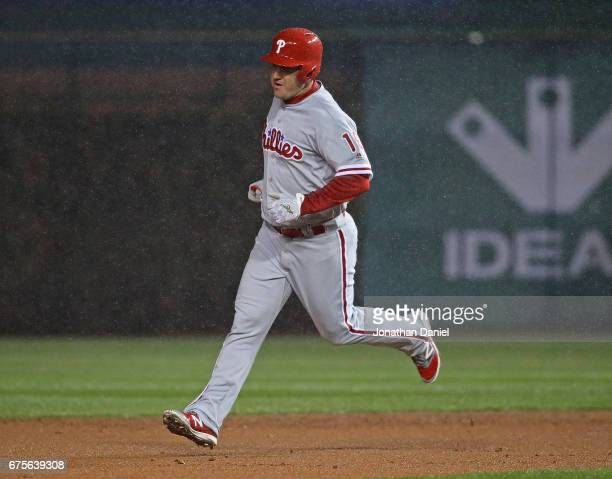 Tommy Joseph of the Philadelphia Phillies runs the bases after hitting a three run home run in the1st inning against the Chicago Cubs at Wrigley...