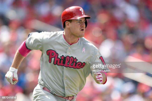 Tommy Joseph of the Philadelphia Phillies runs to first base during game one of baseball game against the Washington Nationals at Nationals Parks on...