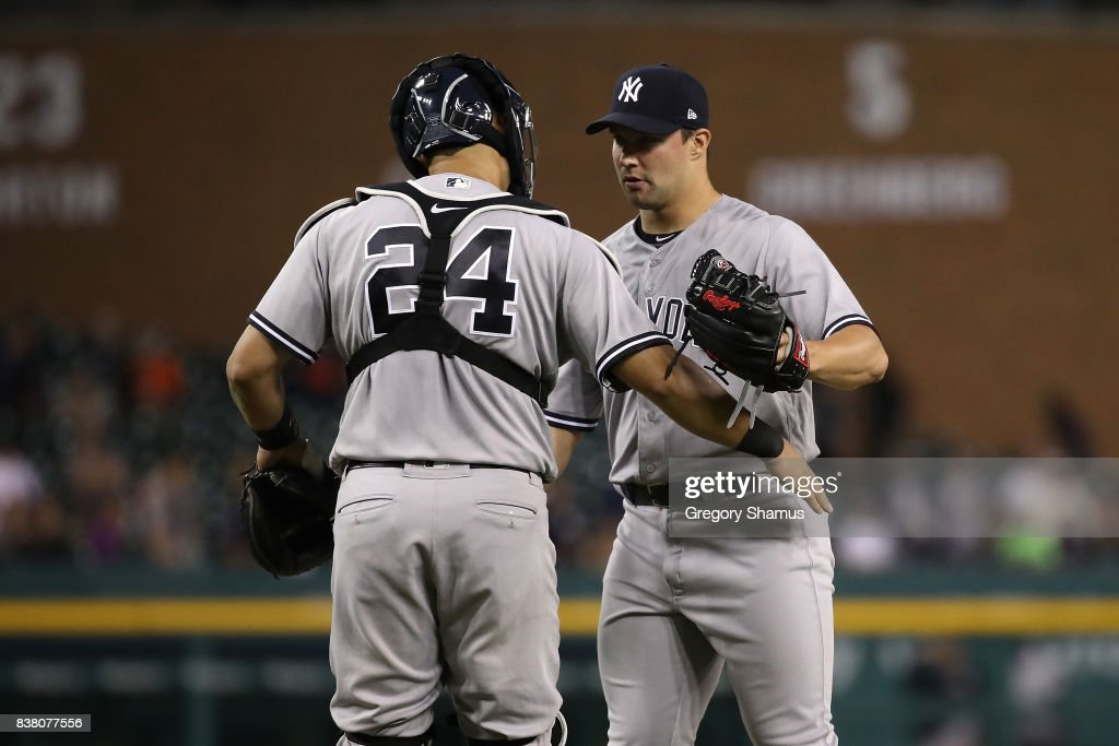 Tommy Kahnle #48 of the New York Yankees celebrates a 10-2 win over the Detroit Tigers with Gary Sanchez #24 at Comerica Park on August 23, 2017 in Detroit, Michigan.