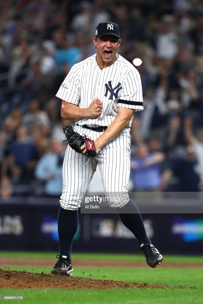 Tommy Kahnle #48 of the New York Yankees celebrates after defeating the Cleveland Indians in Game Four of the American League Divisional Series at Yankee Stadium on October 9, 2017 in the Bronx borough of New York City. The New York Yankees defeated the Cleveland Indians with a score of 7 to 3.