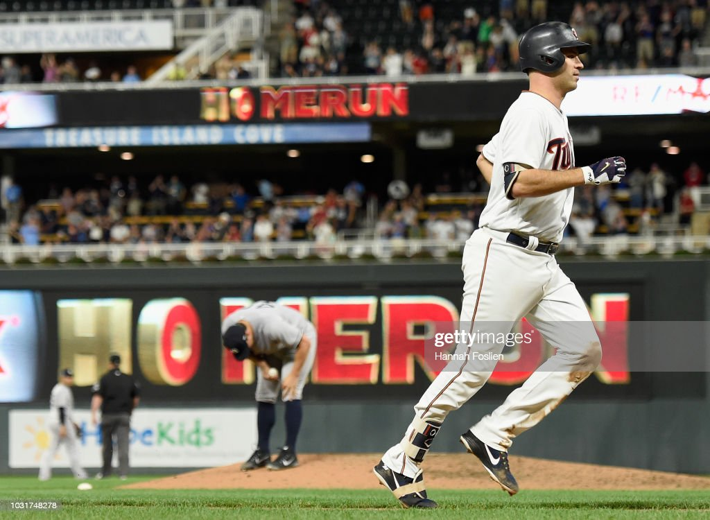 Tommy Kahnle #48 of the New York Yankees looks on as Joe Mauer #7 of the Minnesota Twins rounds the bases after hitting a grand slam during the fifth inning of the game on September 11, 2018 at Target Field in Minneapolis, Minnesota.
