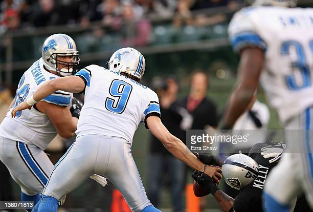 Tommy Kelly of the Oakland Raiders strips the ball from Matthew Stafford of the Detroit Lions that resulted in a fumble recovery and touchdown by...