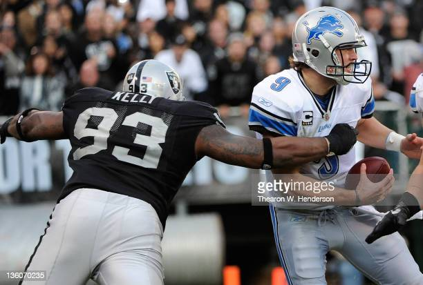 Tommy Kelly of the Oakland Raiders wraps up Matthew Stafford of the Detroit Lions stripping the ball away from him at Oco Coliseum on December 18...