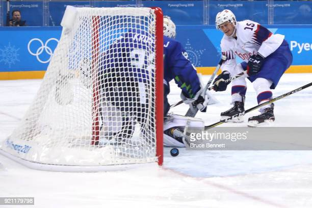 Tommy Kristiansen of Norway scores a goal on Gasper Kroselj of Slovenia in the third period during the Men's Play-offs Qualifications game on day...