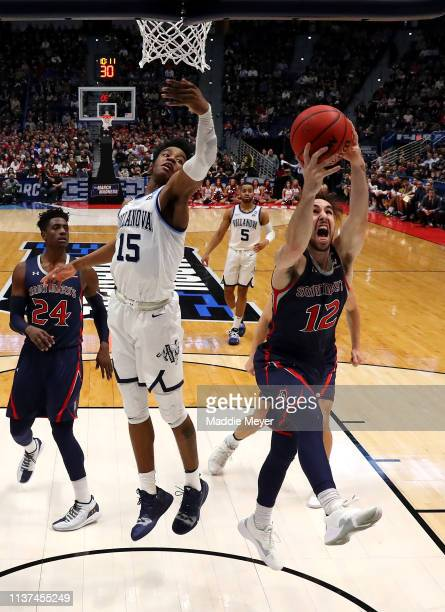 Tommy Kuhse of the Saint Mary's Gaels grabs a rebound against Saddiq Bey of the Villanova Wildcats in the second half during the first round of the...
