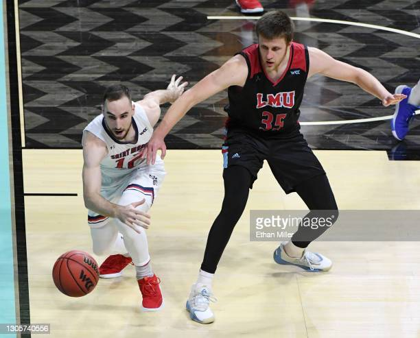 Tommy Kuhse of the Saint Mary's Gaels knocks the ball away from Ivan Alipiev of the Loyola Marymount Lions during the West Coast Conference...