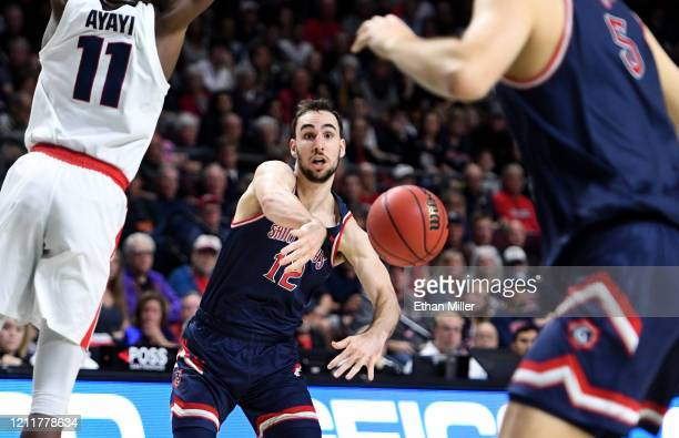 Tommy Kuhse of the Saint Mary's Gaels passes against the Gonzaga Bulldogs during the championship game of the West Coast Conference basketball...