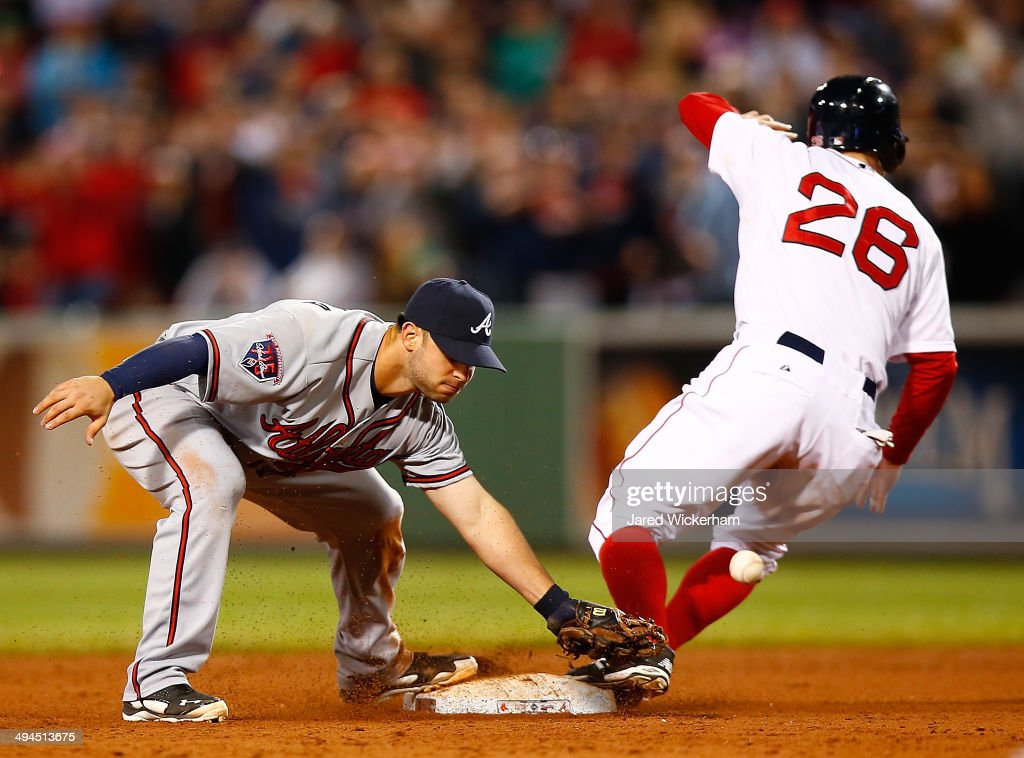 Tommy La Stella #7 of the Atlanta Braves misses catching the throw at second base in front of Brock Holt #26 of the Boston Red Sox that allowed the game-winning run to score from third base in the 9th inning during the game at Fenway Park on May 29, 2014 in Boston, Massachusetts.