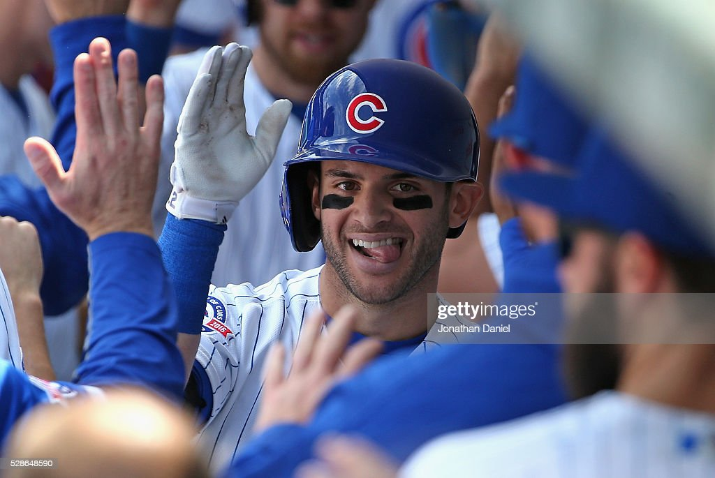 Tommy La Stella #2 of the Chicago Cubs celebrates his two run home run in the 2nd inning against the Washington Nationals with teammates in the dugout at Wrigley Field on May 6, 2016 in Chicago, Illinois.