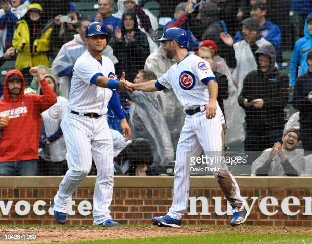 Tommy La Stella of the Chicago Cubs scores with Willson Contreras against the St Louis Cardinals during the eighth inning on September 28 2018 at...