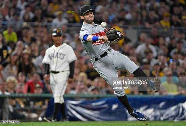 Tommy La Stella of the Chicago Cubs throws to first base but cannot force out Andrew McCutchen of the Pittsburgh Pirates in the sixth inning during...