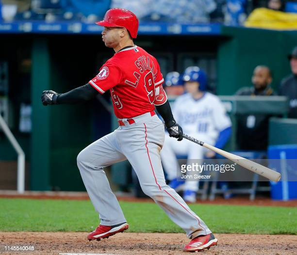 Tommy La Stella of the Los Angeles Angels of Anaheim follows through on a two run single in the fourth inning during the game against the Kansas City...