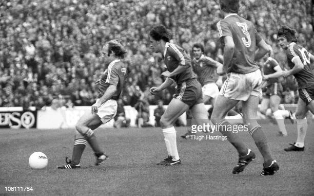 Tommy Langley of Chelsea makes a challenge on Archie Gemmill of Nottingham Forest during the Football League Division One match between Chelsea and...
