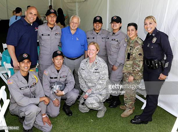 Tommy Lasorda poses with National Guard soldiers at the 44th Annual Los Angeles Police Memorial Foundation Celebrity Golf Tournament at Ron Burkle's...