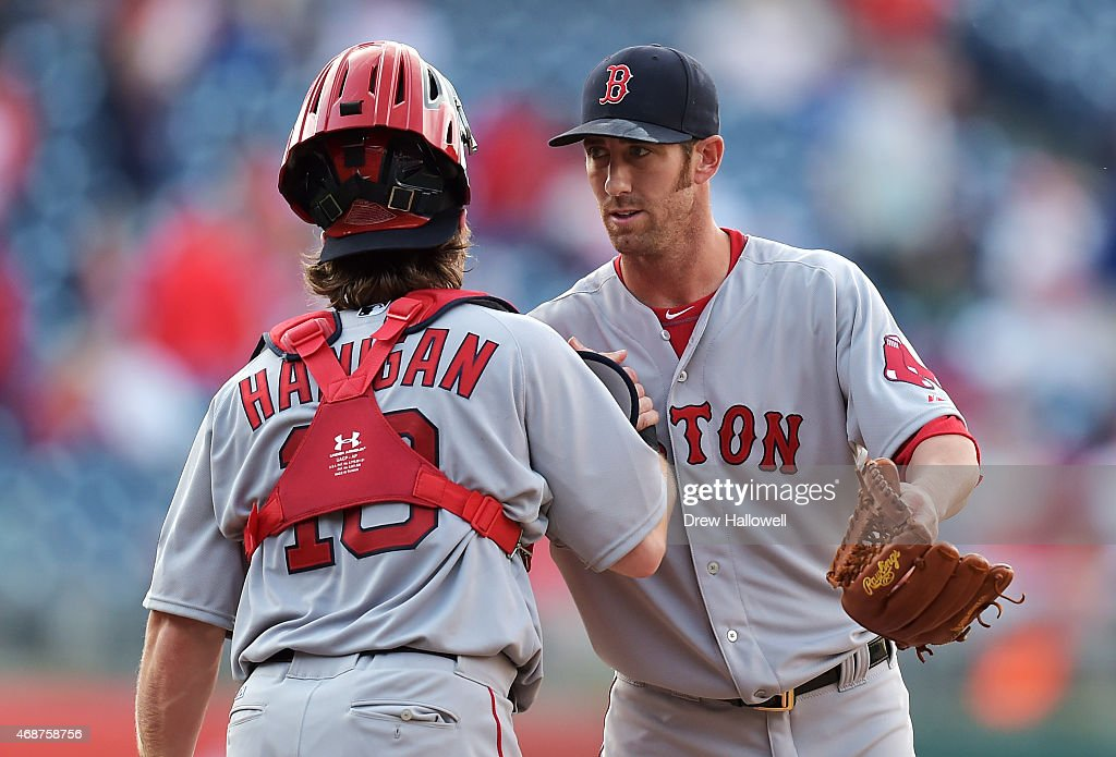 Tommy Layne #59 and Ryan Hanigan #10 of the Boston Red Sox celebrate after an 8-0 win over the Philadelphia Phillies during Opening Day at Citizens Bank Park on April 6, 2015 in Philadelphia, Pennsylvania. The Red Sox won 8-0.