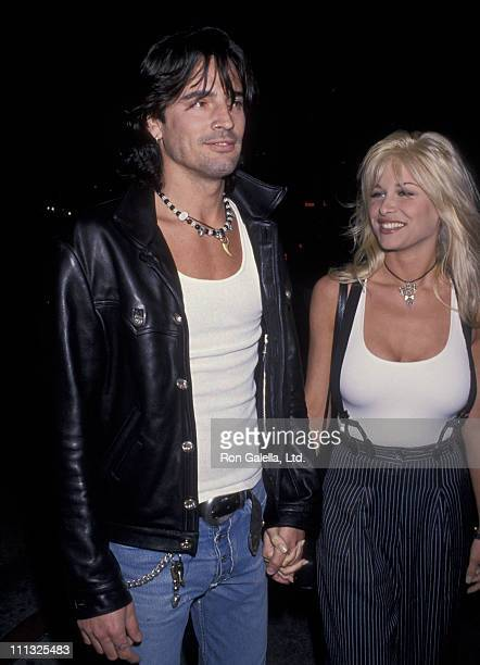 Tommy Lee and Bobbie Brown during 1st Annual Eddie Van Halen Charity Golf Tournament Party at Hard Rock Cafe in West Hollywood California United...