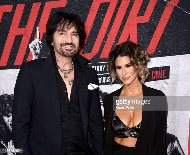 Tommy Lee and Brittany Furlan arrive at the premiere of Netflix's The Dirt at ArcLight Hollywood on March 18 2019 in Hollywood California