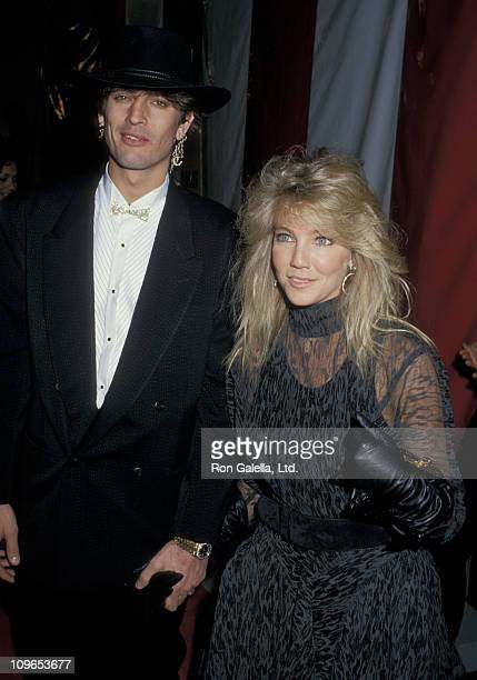 Tommy Lee and Heather Locklear during 15th Annual American Music Awards After Party at Chasen's Restaurant in Beverly Hills California United States