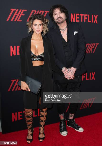 Tommy Lee and his Wife Brittany Furlan attend the Premiere Of Netflix's The Dirt at ArcLight Hollywood on March 18 2019 in Hollywood California
