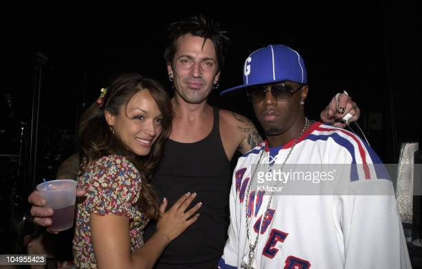 Tommy Lee and new girlfriend Mayte with Sean 'P Diddy' Combs backstage