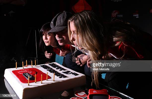 Tommy Lee blows out candles on a cake during Virgin Mobile's 10th Birthday Party at the Metro Theatre on October 28 2010 in Sydney Australia