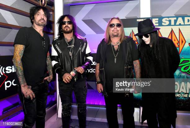 Tommy Lee Nikki Sixx Vince Neil and Mick Mars of Mötley Crüe appear onstage at a press conference with Mötley Crüe Def Leppard and Poison announcing...