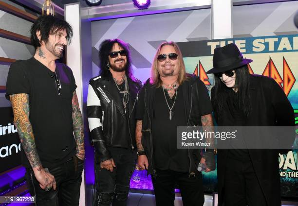 Tommy Lee Nikki Sixx Vince Neil and Mick Mars of Mötley Crüe attend the Press Conference with Mötley Crüe Def Leppard and Poison announcing 2020...